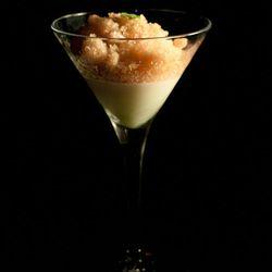 Savory tomato ice with fresh oregano and almond pudding