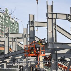 Girder being secured into position in left field -