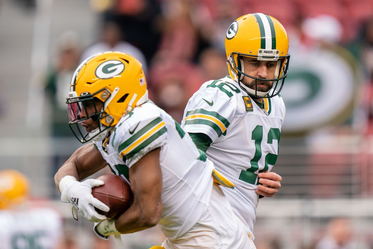 Green Bay Packers quarterback Aaron Rodgers hands off to running back Aaron Jones before the NFC Championship Game against the San Francisco 49ers at Levi's Stadium.