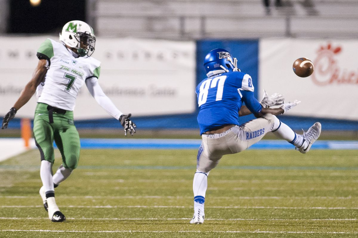 MTSU's Richie James (87) hauls in a pass in front of Marshall's Antavis Rowe (7) in the Blue Raiders' win.