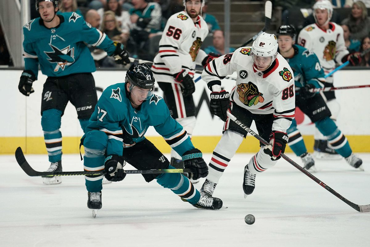 Mar 3, 2019; San Jose, CA, USA; San Jose Sharks right wing Joonas Donskoi (27) and Chicago Blackhawks right wing Patrick Kane (88) chase after the puck during the third period at SAP Center at San Jose.