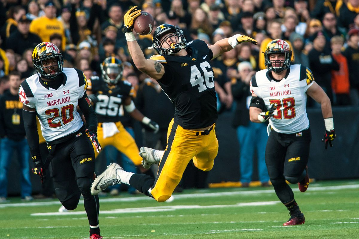 IOWA CITY, IA - Iowa Hawkeyes tight end George Kittle (46) stretches out for a one-handed reception against the Maryland Terrapins defensive secondary at Kinnick Stadium.