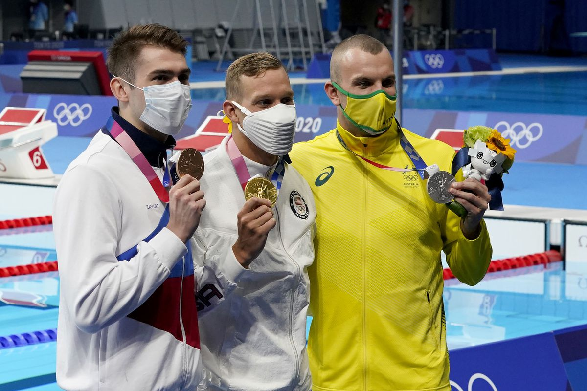 Kliment Kolesnikov (ROC), from left, Caeleb Dressel (USA) and Kyle Chalmers (AUS) pose with their medals after competing in the men's 100m freestyle final during the Tokyo 2020 Olympic Summer Games at Tokyo Aquatics Centre. Mandatory Credit: Grace Hollars