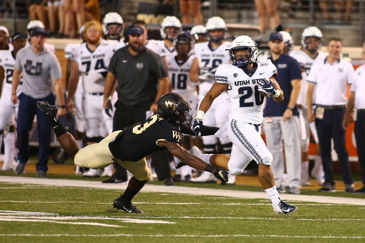 Wake Forest defensive back Nasir Greer dives to make the tackle on Utah State running back Jaylen Warren.