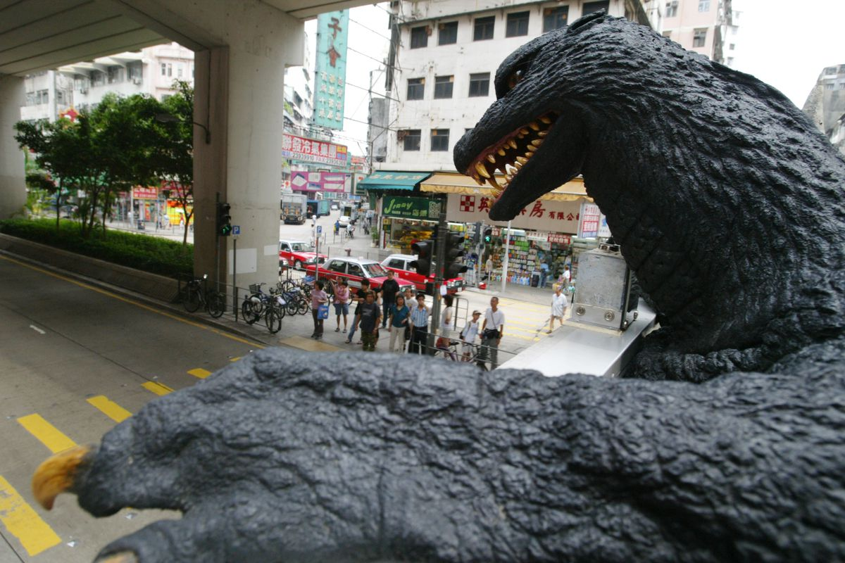 Godzilla touring around Hong Kong on a bus to unveil the opening of the Animation Festival organised by the HKIFF, pictured taken in Mong Kok. July 14, 2006