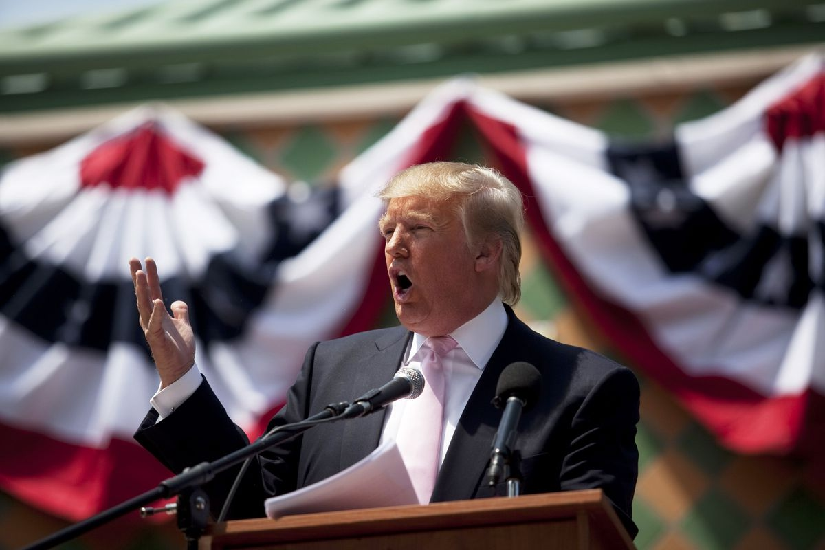 Billionaire Donald Trump speaks to a crowd at the 2011 Palm Beach County Tax Day Tea Party on April 16, 2011, at Sanborn Square in Boca Raton, Florida.