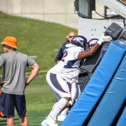 Broncos DE Zach Kerr and co. work the sled.