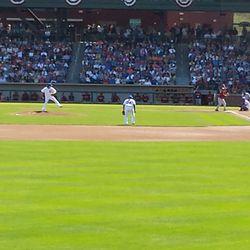 Jeff Samardzija throws the first pitch in Cubs Park history to Gerardo Parra