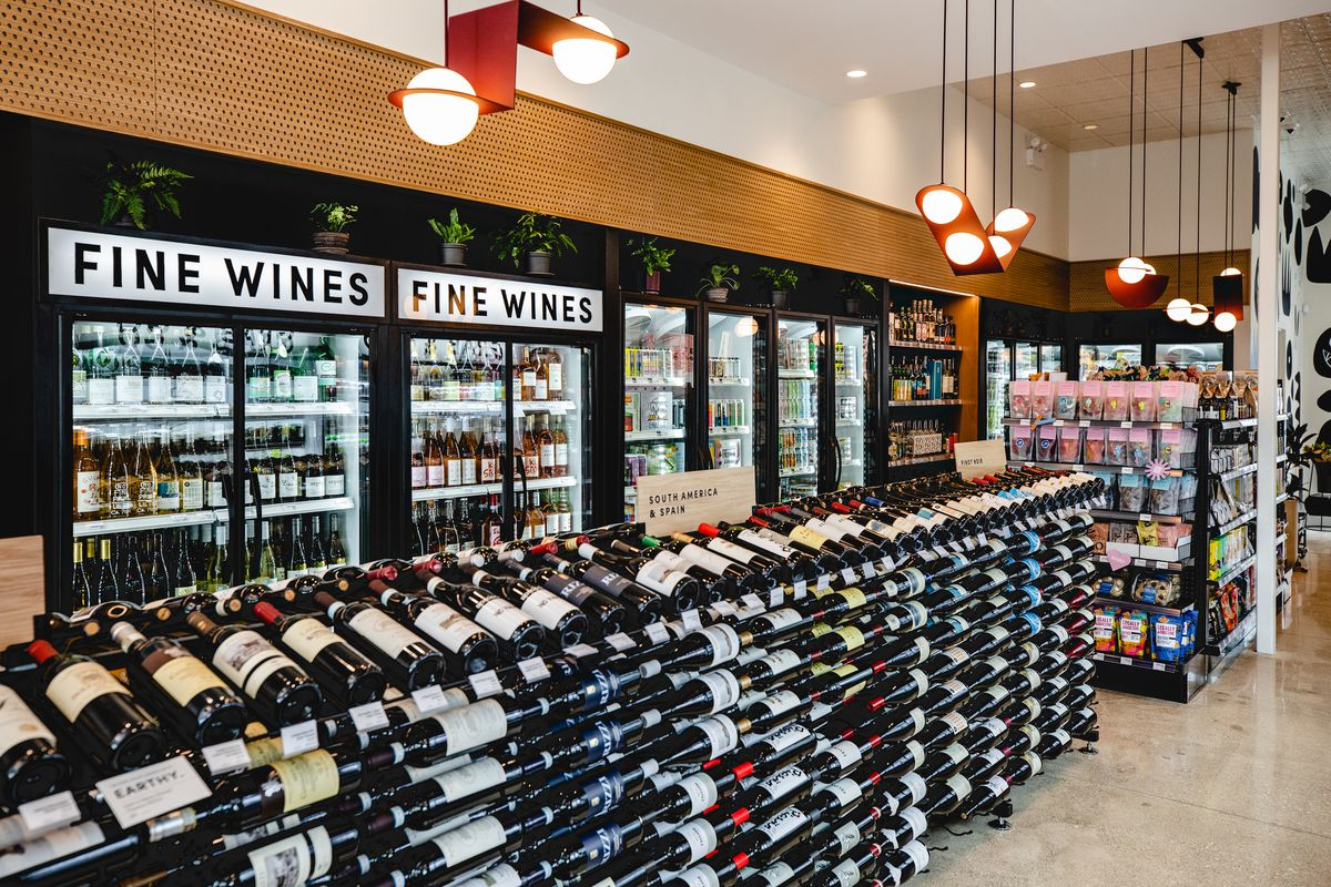 A retail section of hundreds of bottles of wine.