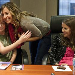 """Olympic silver medalist Noelle Pikus-Pace hugs Tara Jeppsen, 13, during a small group discussion about her new book, """"Focused: Keeping Your Life on Track, One Choice at a Time,"""" at Deseret Book corporate headquarters, Tuesday, Sept. 9, 2014."""