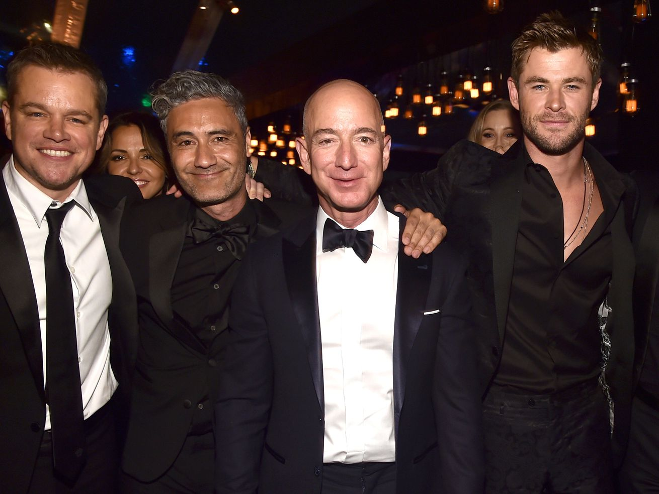 left to right: Matt Damon, Taika Waititi, Amazon founder and CEO Jeff Bezos, and Chris Hemsworth at the Golden Globe Awards.