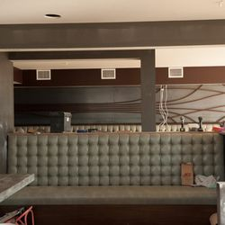 The dining room banquette and wall sculpture created by Paul Lewin's Chicago design studio, Sagen.