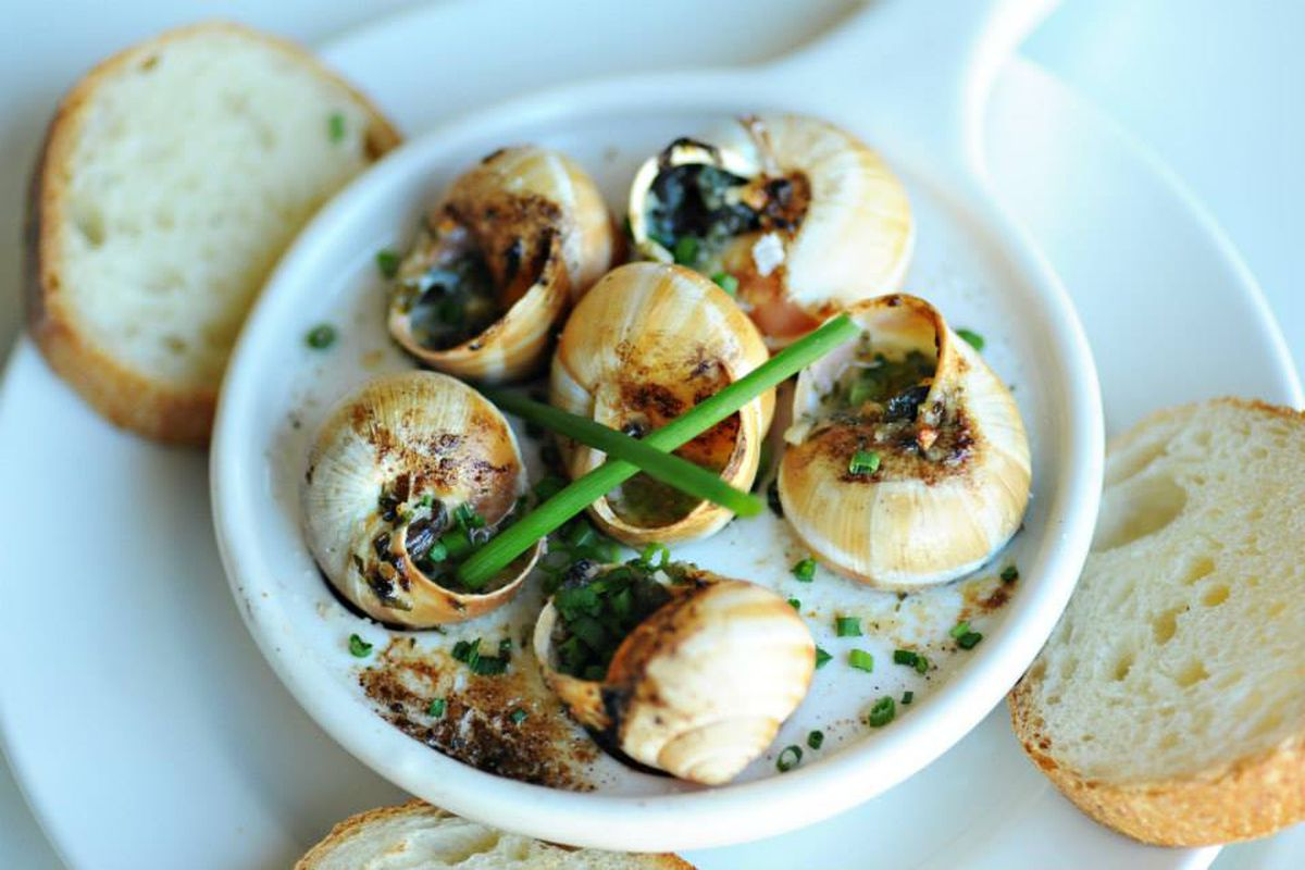 escargots served in shell and garnished with herbs