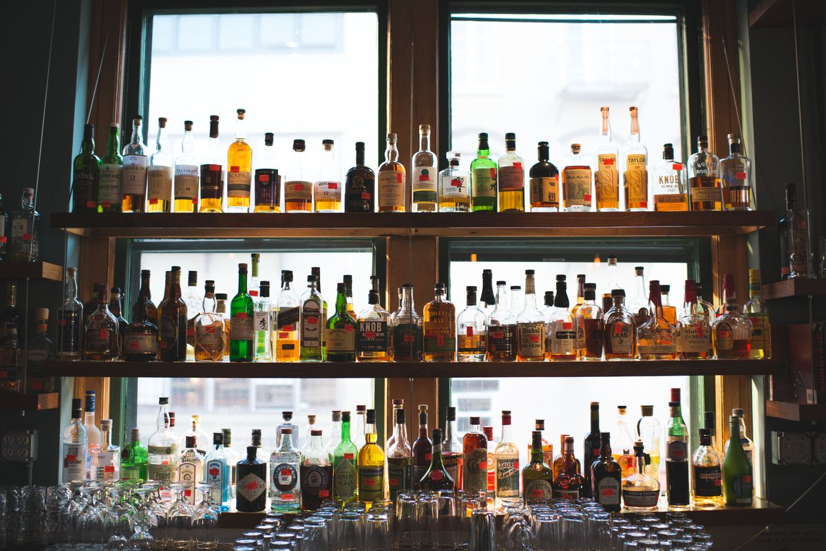 Shelves of liquor on display at Table.