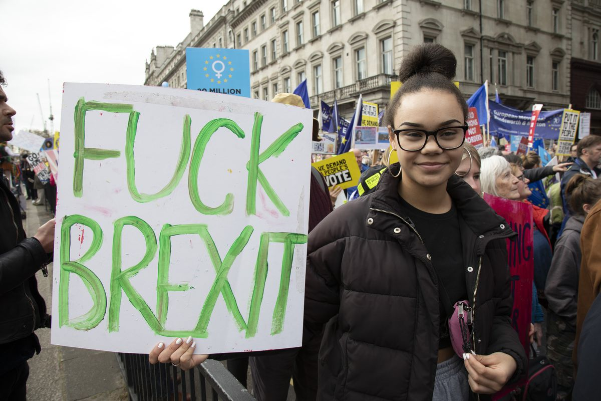 "A demonstrator holds a placard that reads ""Fuck Brexit"" during the People's Vote anti-Brexit march in London on March 23, 2019."