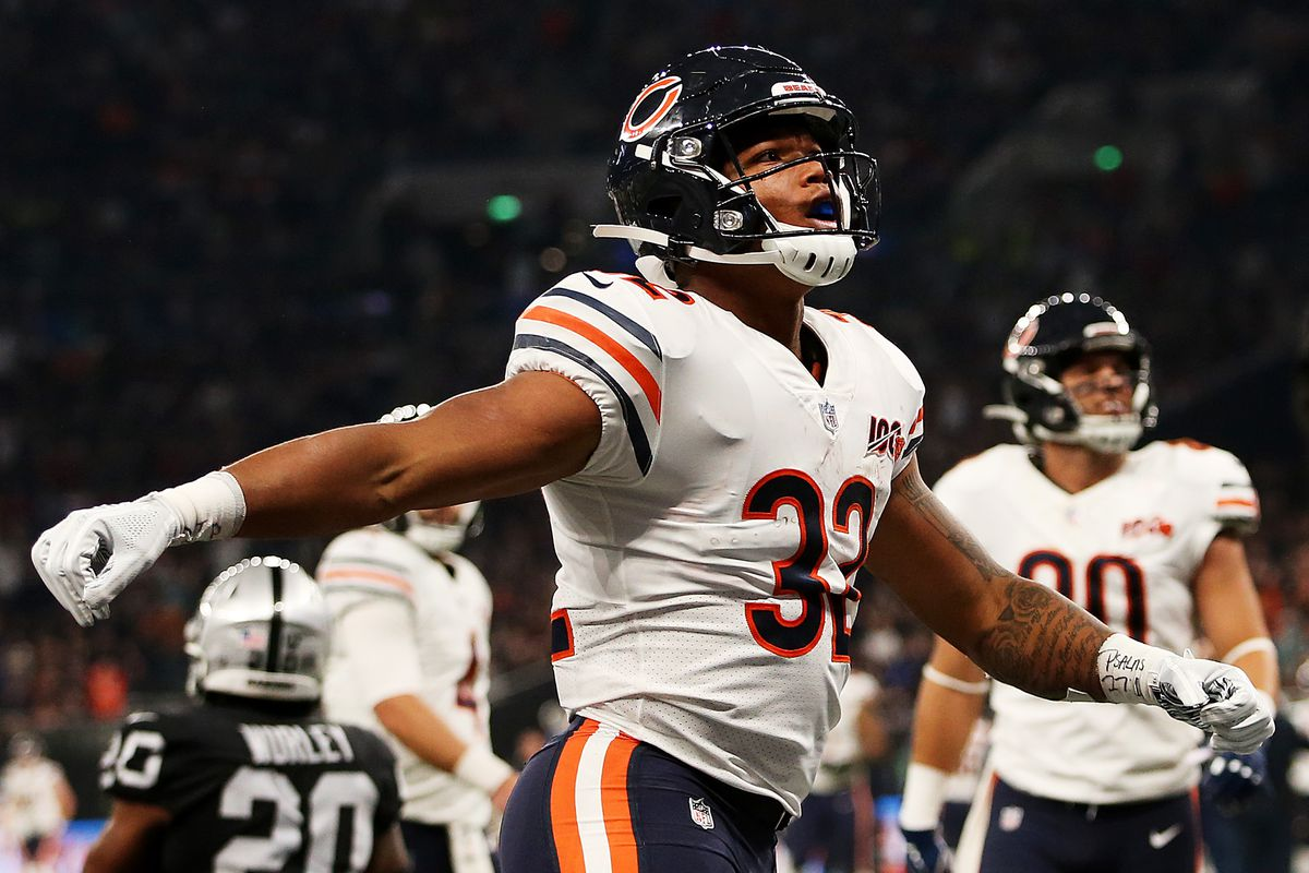 David Montgomery of the Chicago Bears celebrates after rushing in his team's first touchdown during the match between the Chicago Bears and Oakland Raiders at Tottenham Hotspur Stadium on October 06, 2019 in London, England.