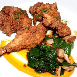 """Country fried rabbit with carrot habanero sauce, baby spinach, sunchokes, lamb bacon and rabbit jus from the Momofuku OG Dinner at the Brooklyn Star by <a href=""""http://www.flickr.com/photos/37619222@N04/8611184359/in/pool-eater/"""">The Food Doc</a>"""