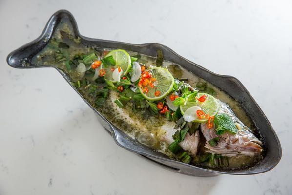 Whole steamed branzino at Fish Cheeks