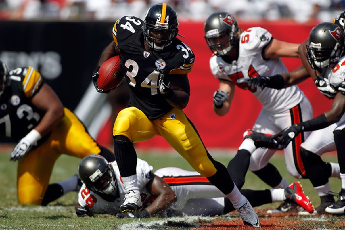 TAMPA FL - SEPTEMBER 26:  Running back Rashard Mendenhall #34 of the Pittsburgh Steelers runs the ball against the Tampa Bay Buccaneers during the game at Raymond James Stadium on September 26 2010 in Tampa Florida.  (Photo by J. Meric/Getty Images)