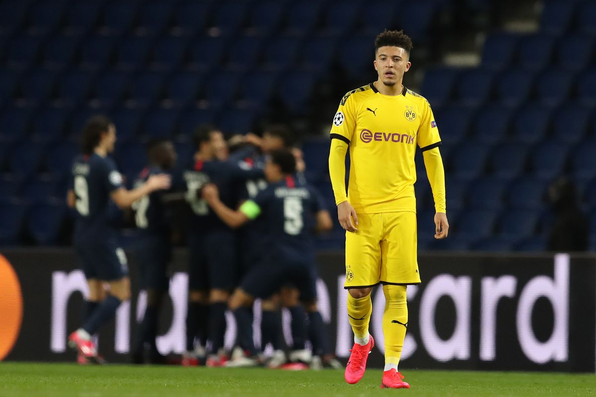 In this handout image provided by UEFA, Jadon Sancho of Borussia Dortmund reacts to PSG scoring their second goal during the UEFA Champions League round of 16 second leg match between Paris Saint-Germain and Borussia Dortmund at Parc des Princes on March 11, 2020 in Paris, France.