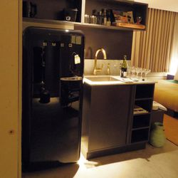 The stylish, well-stocked kitchenette at Ace's cool terrace suite.