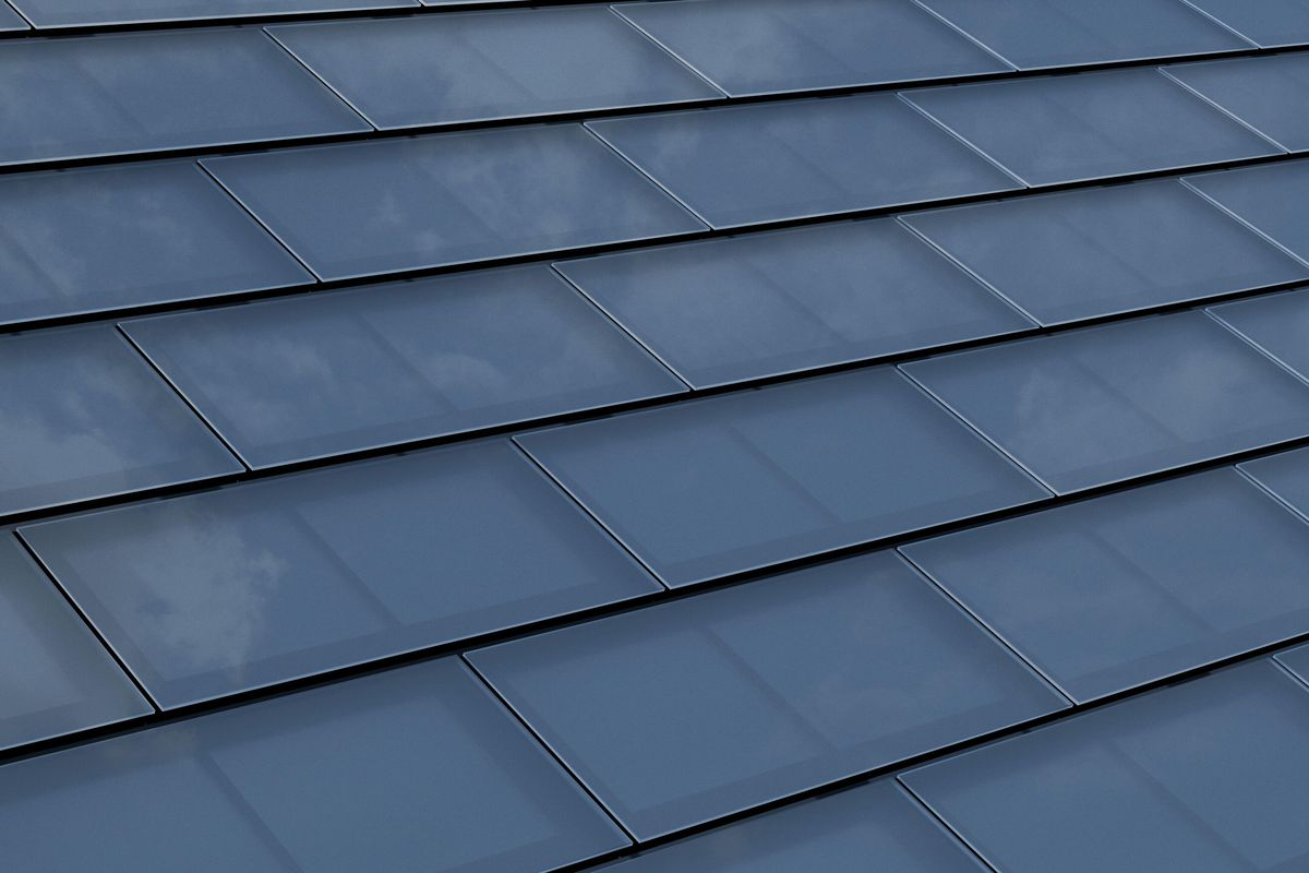A close up image of Tesla solar tiles on the roof of a home.