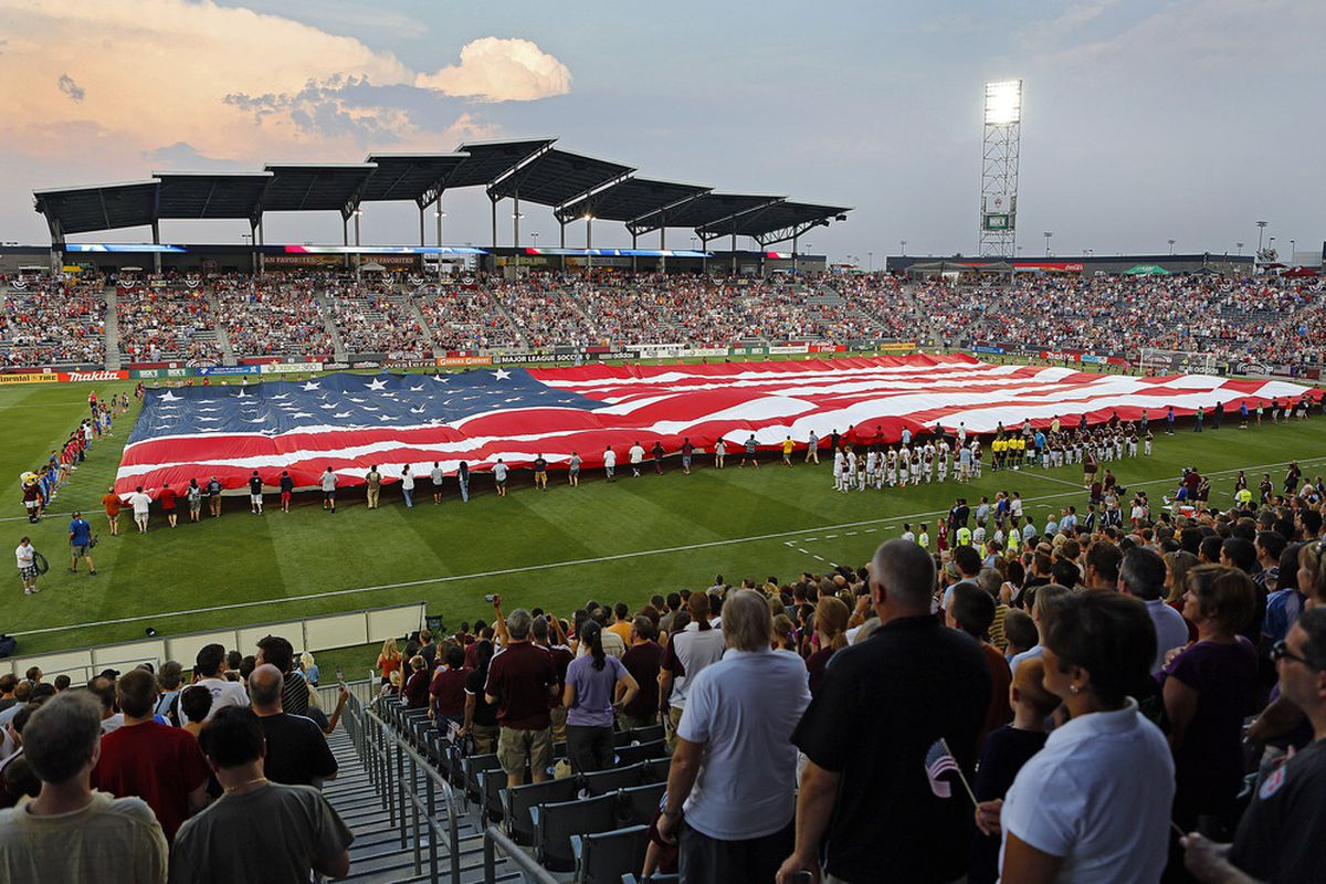 COMMERCE CITY, CO - JULY 4: A huge American flag is unfurled on the field at Dick's Sporting Goods Park July 4, 2012 in Commerce City, Colorado as the national anthem is played before the start of the game. (Photo by Marc Piscotty/Getty Images)