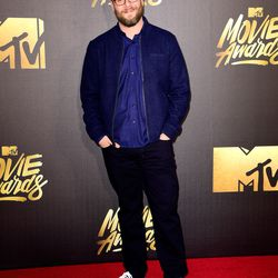 Seth Rogen wears a blue top and black bottoms.