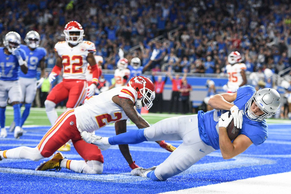Detroit Lions tight end T.J. Hockenson scores a touchdown as Kansas City Chiefs defensive back Bashaud Breeland attempts to break up the play during the first quarter at Ford Field.