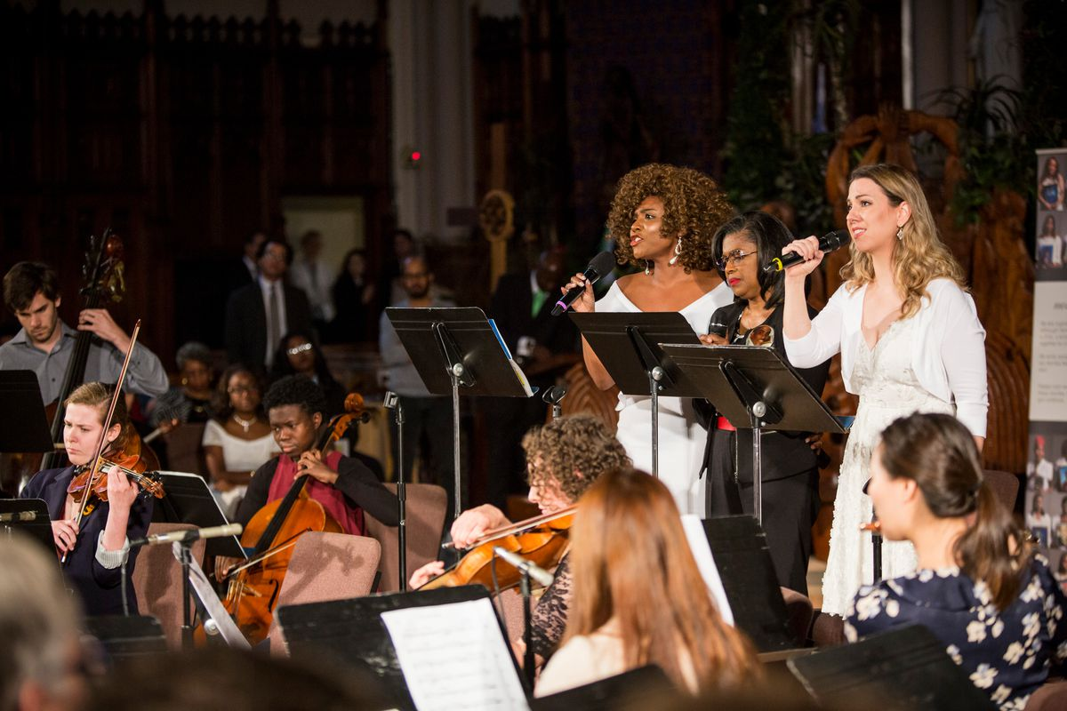 Soprano Takesha Meshé Kizart (from left), Athanette Marshbanks and mezzo-soprano Sarah Ponder perform Sunday at the Concert For Peace at Saint Sabina Church. | James Foster/For the Sun-Times