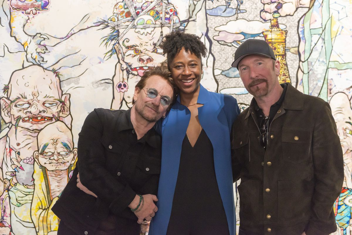 U2's Bono and The Edge were given a tour of the Takashi Murakami exhibit at the MCA by curator Naomi Beckwith earlier this month when the band played Soldier Field. | PHOTO COURTESY THE MCA