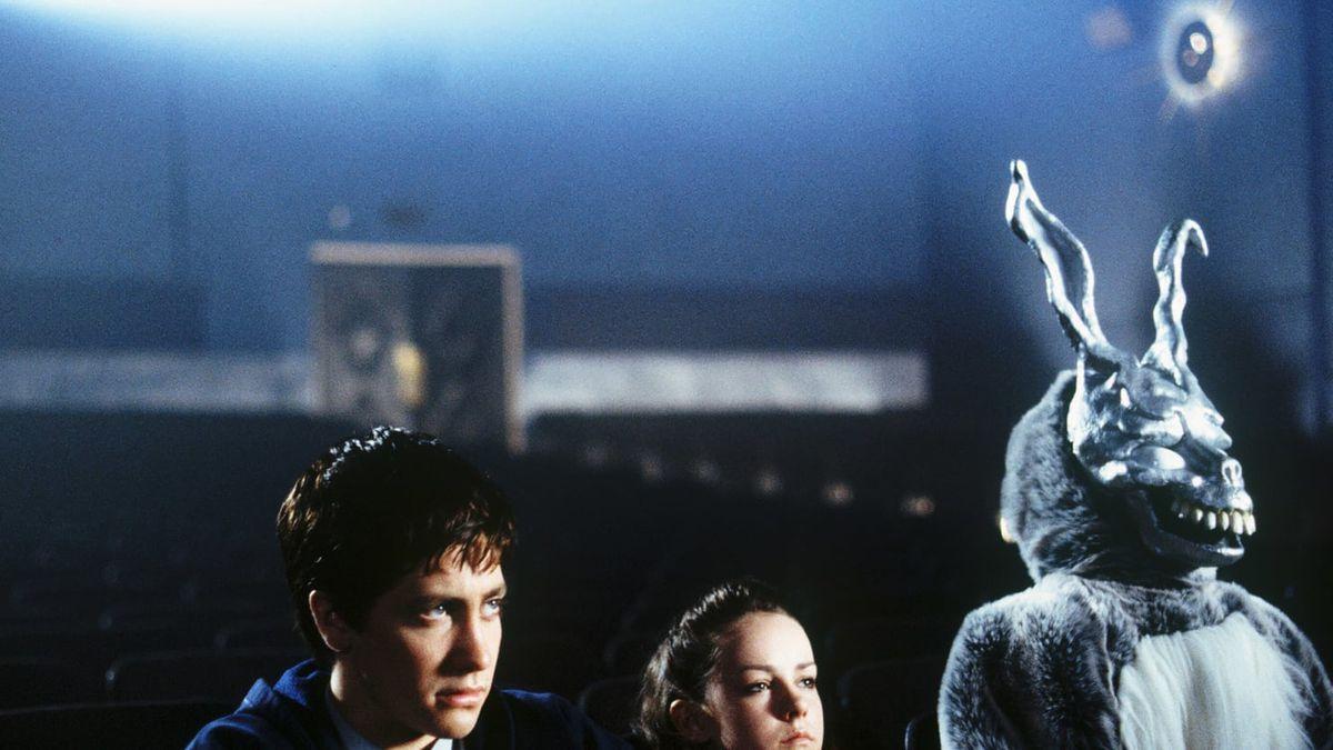 A boy and a girl next to a deranged rabbit in 'Donnie Darko'