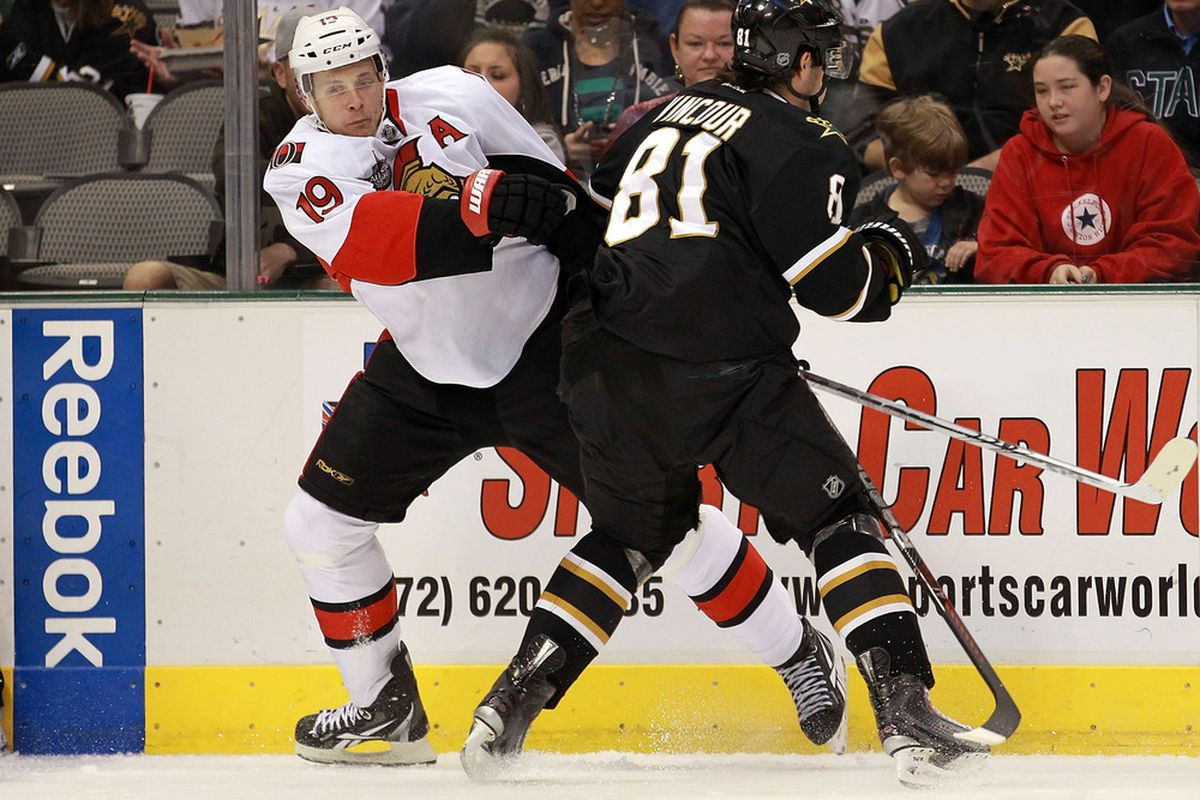 DALLAS, TX - DECEMBER 01:  Jason Spezza #19 of the Ottawa Senators skates the puck against Tomas Vincour #81 of the Dallas Stars at American Airlines Center on December 1, 2011 in Dallas, Texas.  (Photo by Ronald Martinez/Getty Images)