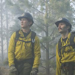 """Brendan McDonough (Miles Teller) and Chris MacKenzie (Taylor Kitsch) plan to do the backburn at the Chiricahua Mountain fireline in Columbia Pictures' """"Only the Brave."""""""