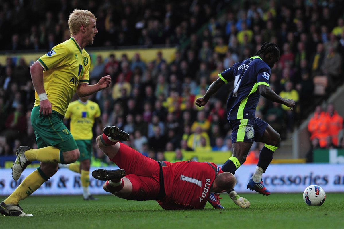 Victor Moses of Wigan Athletic goes round John Ruddy of Norwich City to score a goal during the Barclays Premier League match between Norwich City and Wigan Athletic at Carrow Road.