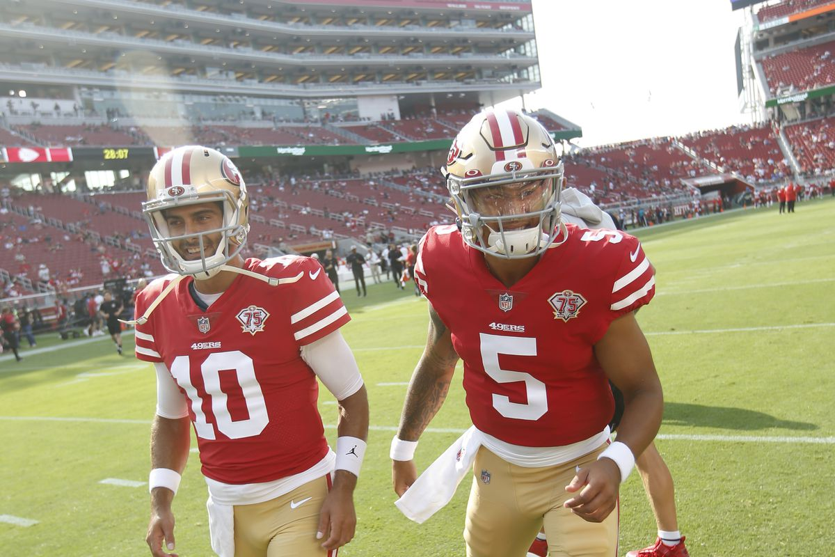 Jimmy Garoppolo #10 and Trey Lance #5 of the San Francisco 49ers on the field before the preseason game against the Kansas City Chiefs at Levi's Stadium on August 14, 2021 in Santa Clara, California.