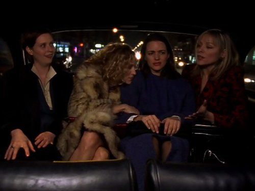 """The four women of """"Sex and the City"""" sitting in the back of a car."""