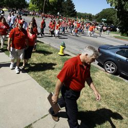 """Hundreds of teachers from Ogden City School District, their families and others from surrounding districts, follow Doug Stephens of the Ogden Education Association as they walk from a rally, to the Ogden school district offices to have their questions answered Thursday, July 14, 2011, about the """"take it or leave it"""" contract issued them several weeks ago."""