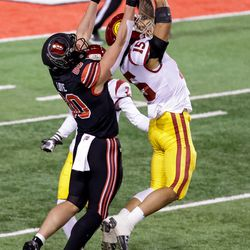 USC Trojans safety Talanoa Hufanga (15) intercepts a pass intended for Utah Utes tight end Brant Kuithe (80) at Rice-Eccles Stadium in Salt Lake City on Saturday, Nov. 21, 2020.