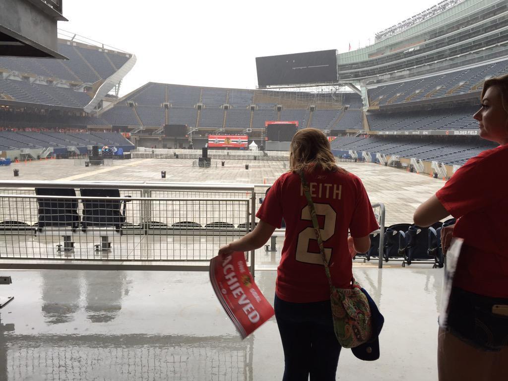Fans wait out the rain at Soldier Field. | Ashlee Rezin / for the Sun-Times