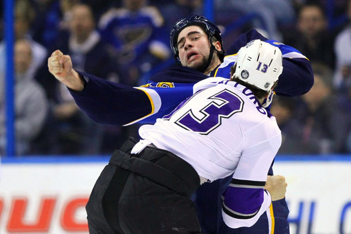 ST. LOUIS MO - JANUARY 18: Roman Polak #46 of the St. Louis Blues fights Kyle Clifford #13 of the Los Angeles Kings at the Scottrade Center on January 18 2011 in St. Louis Missouri.  (Photo by Dilip Vishwanat/Getty Images)