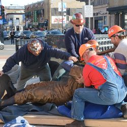 5:15 p.m. The Ernie Banks statue being lifted -