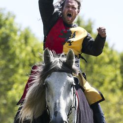Josh Avery cheers after making a successful spear throw during the Knights of Mayhem jousting competition during the Utah Renaissance Faireat Thanksgiving Point's Electric Park in Lehi on Friday, Aug. 23, 2019.