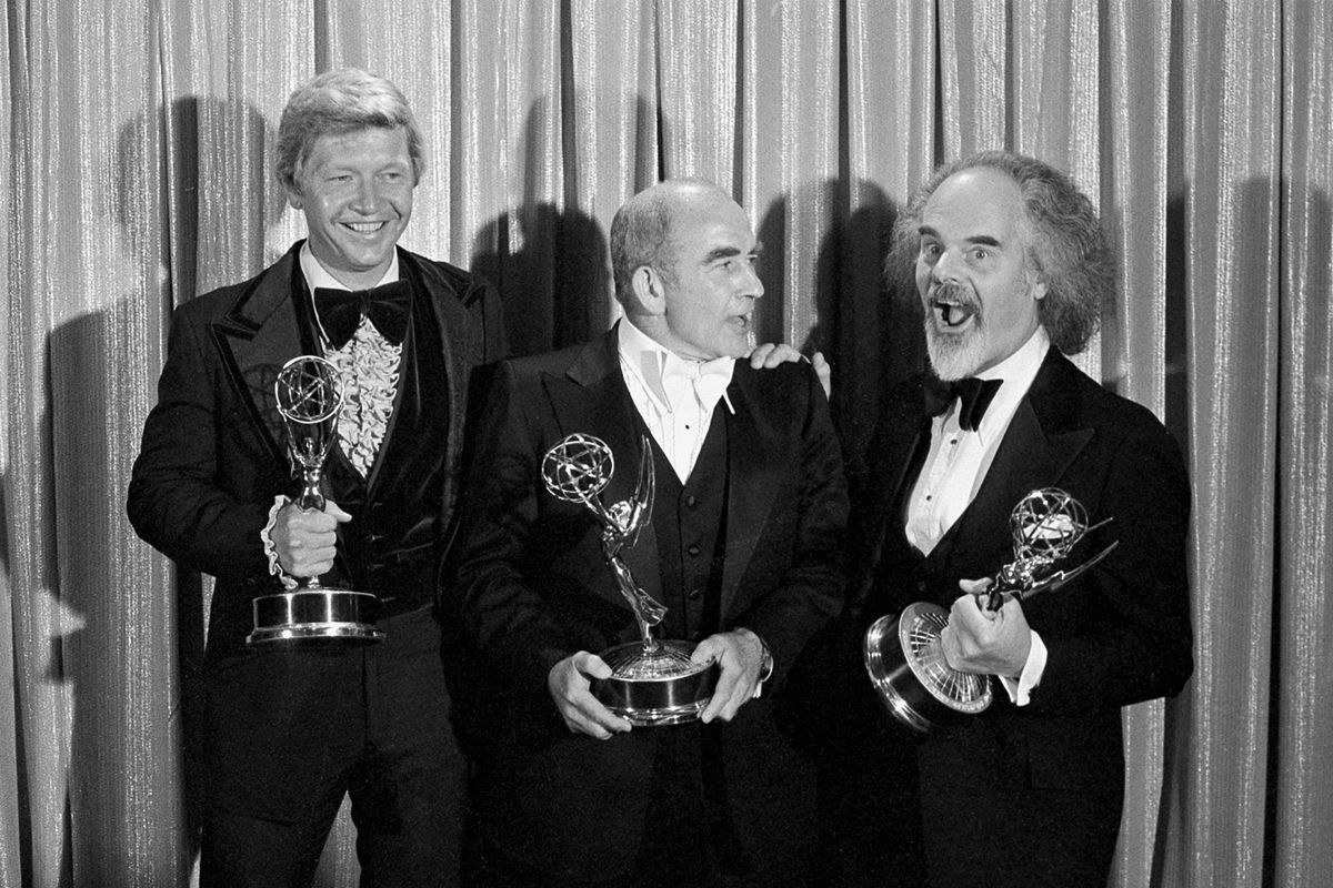 In this 1977 file photo, screenwriter William Blinn (from left), Ed Asner and David Greene pose with their Emmy statuettes at the annual Primetime Emmy Awards presentation in Los Angeles. Blinn died Thursday; he was 83.