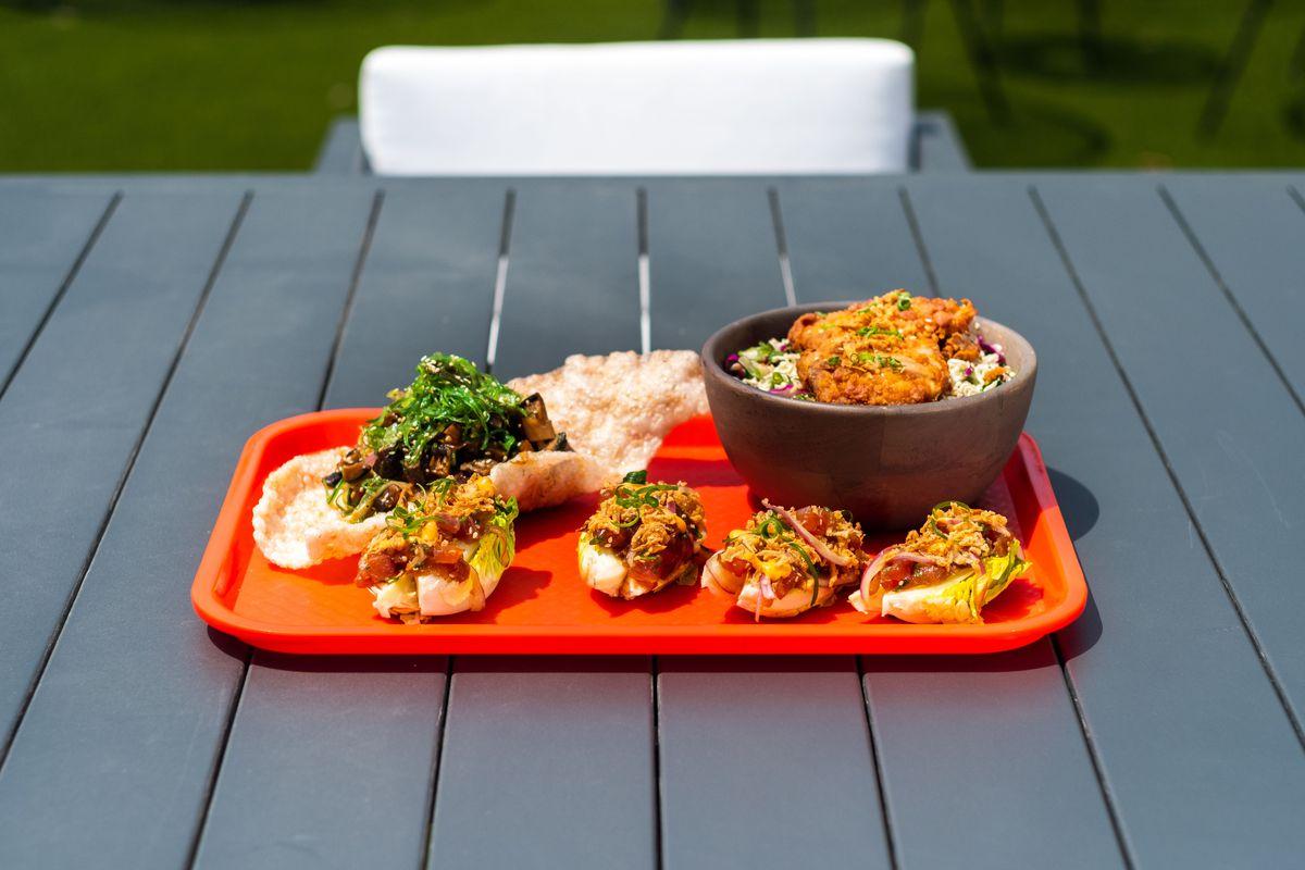 A tray of mushroom poke on a picnic table outside