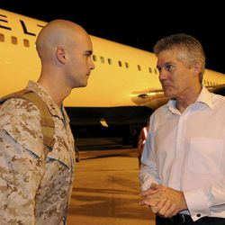 In this photo released by Australian Department of Defence, U.S. Marine Corps Company Commander Captain Christopher Richardella, left, of Fox Company, 2nd Battalion 3rd Marine Regiment, is greeted by Australia's Minister for Defence Stephen Smith upon arrival at RAAF Base Darwin in Darwin, Australia, late Tuesday night, April 3, 2012. Approximately 200 Marines of Fox Company, 2nd Battalion 3rd Marine Regiment, arrived at the base to begin the lead up to moving out field and commencing exercises in some of the Australian Defence Force's premier training areas in northern Australia.
