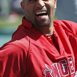 Los Angeles Angels first baseman Albert Pujols laughs while stretching on the field before the a baseball game against the New York Yankees at Yankee Stadium in New York, Friday, April 13, 2012.
