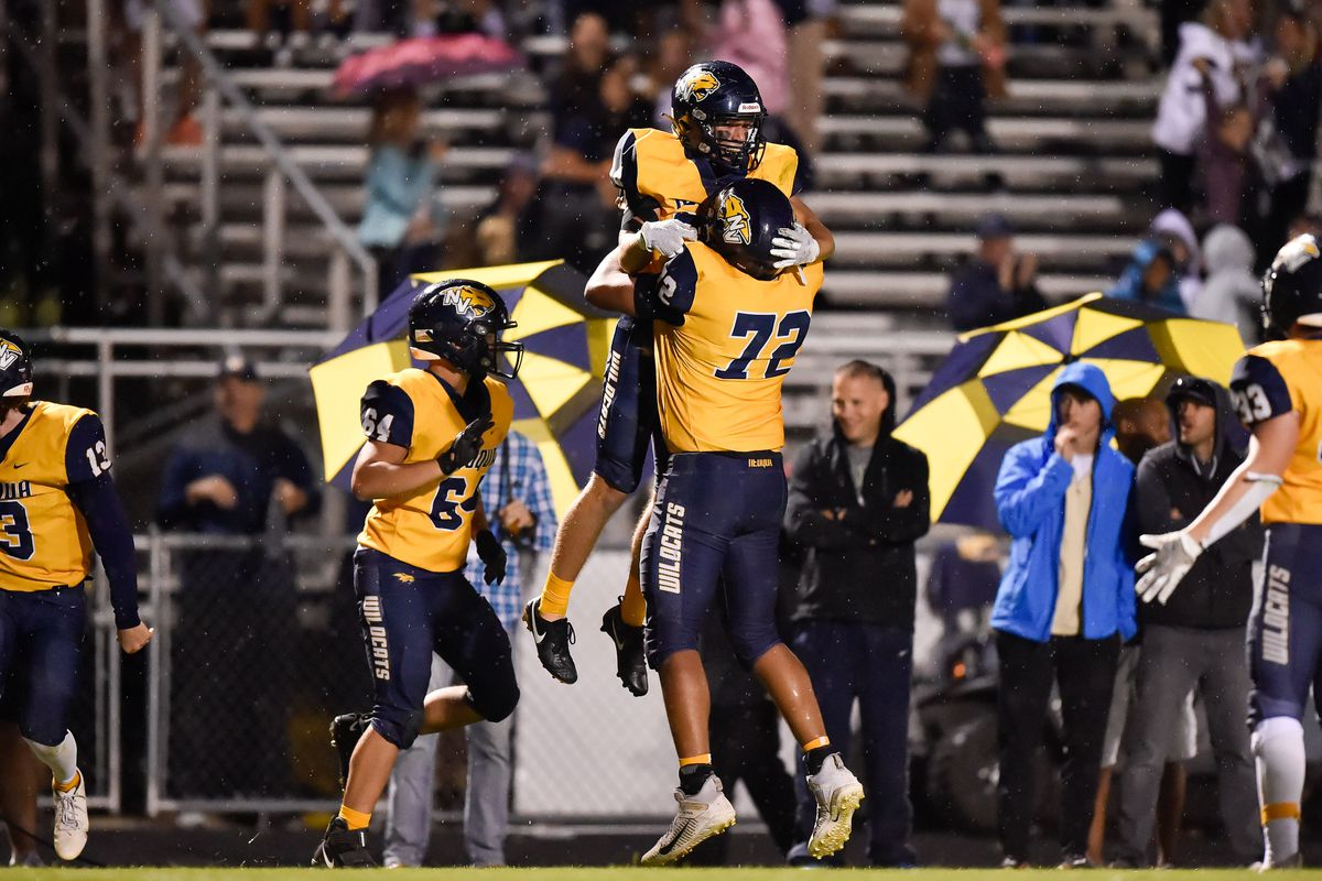 Neuqua Valley's Palmer Domschke (34) is liften in the air by Nicholas Gallegos (72) in celebration after scoring a touchdown in overtime against Naperville Central.