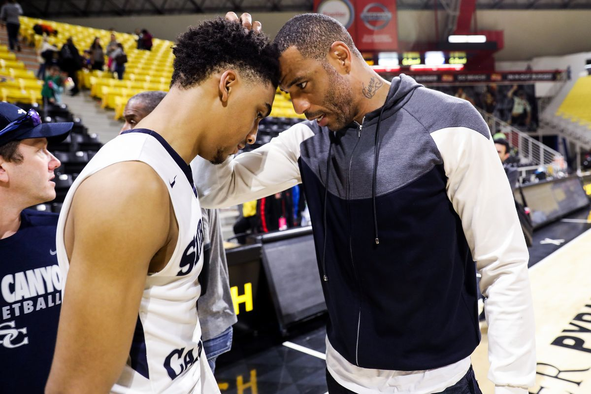 Kenyon Martin Jr. of the Sierra Canyon Trailblazers shares a moment with his father, Kenyon Martin Sr., after their victory against the against the Etiwanda Eagles for the CIF State Regional Finals on March 17, 2018 in Long Beach, California.