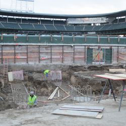 Closer view of excavation in the left-field bleachers